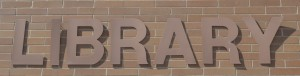image of a sign on the exterior wall of a library